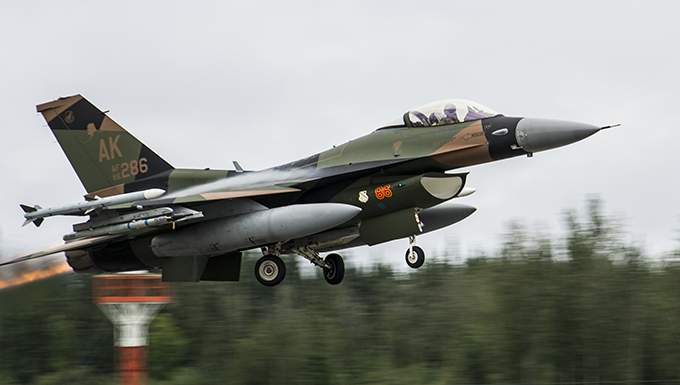 A U.S. Air Force F-15 Eagle assigned to the 67th Fighter Squadron takes off during RED FLAG-Alaska 19-3 at Eielson Air Force Base,  Alaska, Aug. 5, 2019. This U.S. Pacific Air Forces large force exercise enables U.S. and international forces to strengthen partnerships and improve interoperability by sharing tactics, techniques and procedures for multi-domain operations. (U.S. Air Force photo by Senior Airman Isaac Johnson)
